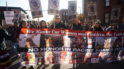 """<p>               Protesters march from Peavey Park to US Bank Stadium to protest the use of """"Redskins"""" in the name of the Washington NFL football team, and the names of some other pro sports teams, before Washington's game against the Minnesota Vikings on Thursday, Oct. 24, 2019, in Minneapolis. (Richard Tsong-Taatrarii/Star Tribune via AP)             </p>"""