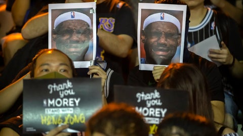 <p>               Demonstrators hold up photos of LeBron James grimacing during a rally at the Southorn Playground in Hong Kong, Tuesday, Oct. 15, 2019. Protesters in Hong Kong have thrown basketballs at a photo of LeBron James and chanted their anger about comments the Los Angeles Lakers star made about free speech during a rally in support of NBA commissioner Adam Silver and Houston Rockets general manager Daryl Morey, whose tweet in support of the Hong Kong protests touched off a firestorm of controversy in China. (AP Photo/Mark Schiefelbein)             </p>