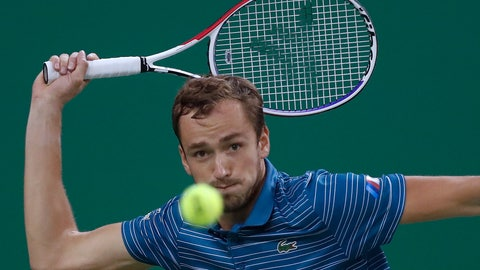 <p>               Daniil Medvedev of Russia eyes on the ball as he plays against Stefanos Tsitsipas of Greece in their men's singles semifinals match at the Shanghai Masters tennis tournament at Qizhong Forest Sports City Tennis Center in Shanghai, China, Saturday, Oct. 12, 2019. (AP Photo/Andy Wong)             </p>