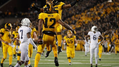 <p>               Iowa running back Tyler Goodson, top, congratulates wide receiver Brandon Smith on his touchdown during the second half of an NCAA college football game against Penn State, Saturday, Oct. 12, 2019, in Iowa City, Iowa. Penn State won 17-12. (AP Photo/Matthew Putney)             </p>