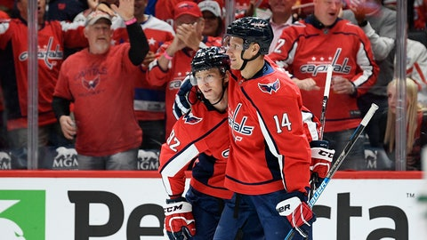 <p>               Washington Capitals center Evgeny Kuznetsov (92), of Russia, celebrates his goal with right wing Richard Panik (14) during the first period of the team's NHL hockey game against the Dallas Stars, Tuesday, Oct. 8, 2019, in Washington. (AP Photo/Nick Wass)             </p>