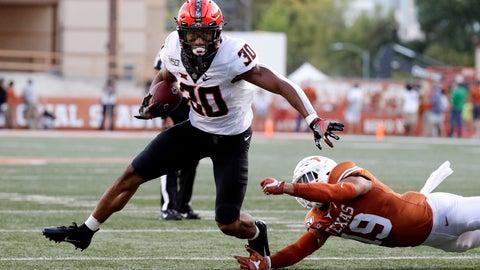 <p>               Oklahoma State running back Chuba Hubbard (30) runs past Texas defensive back Brandon Jones (19) during the first half of an NCAA college football game Saturday, Sept. 21, 2019, in Austin, Texas. (AP Photo/Eric Gay)             </p>