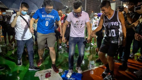 <p>               Demonstrators stamp on Lebron James jerseys during a rally at the Southorn Playground in Hong Kong, Tuesday, Oct. 15, 2019. Protesters in Hong Kong have thrown basketballs at a photo of LeBron James and chanted their anger about comments the Los Angeles Lakers star made about free speech during a rally in support of NBA commissioner Adam Silver and Houston Rockets general manager Daryl Morey, whose tweet in support of the Hong Kong protests touched off a firestorm of controversy in China. (AP Photo/Mark Schiefelbein)             </p>