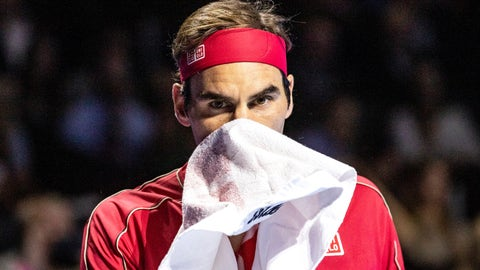 <p>               Roger Federer of Switzerland wipes his face during the semifinal match against Stefanos Tsitsipas of Greece at the Swiss Indoors tennis tournament at the St. Jakobshalle in Basel, Switzerland, Saturday, Oct. 26, 2019. (Alexandra Wey/Keystone via AP)             </p>
