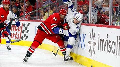 <p>               Carolina Hurricanes' Jordan Martinook (48) collides with Tampa Bay Lightning's Carter Verhaeghe (23) during the first period of an NHL hockey game in Raleigh, N.C., Sunday, Oct. 6, 2019. (AP Photo/Karl B DeBlaker)             </p>