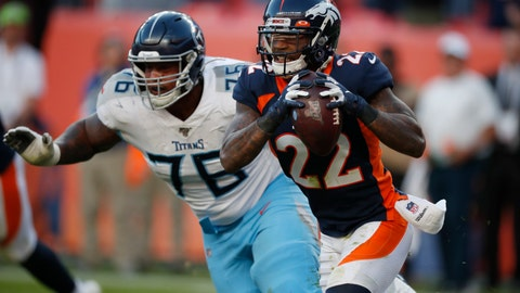 <p>               Denver Broncos defensive back Kareem Jackson (22) intercepts a pass as Tennessee Titans offensive guard Rodger Saffold chases during the second half of an NFL football game Sunday, Oct. 13, 2019, in Denver. (AP Photo/David Zalubowski)             </p>
