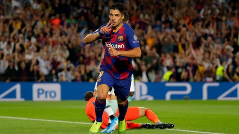 <p>               Barcelona's Luis Suarez celebrates after scoring his side's second goal during the group F Champions League soccer match between F.C. Barcelona and Inter Milan at the Camp Nou stadium in Barcelona, Spain, Wednesday, Oct. 2, 2019. (AP Photo/Emilio Morenatti)             </p>