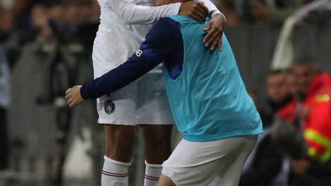 <p>               PSG's Kylian Mbappe celebrates his goal with PSG's PSG's Marco Verratti during the French League One soccer match between Nice and Paris Saint Germain in Allianz Riviera stadium in Nice, southern France, Friday, Oct.18, 2019. (AP Photo/Daniel Cole)             </p>