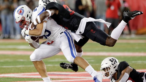 <p>               SMU tight end Kylen Granson (83) is tackled by Houston safety Gervarrius Owens, top, and safety Amaud Willis-Dalton, right, during the first half of an NCAA college football game Thursday, Oct. 24, 2019, in Houston. (AP Photo/Michael Wyke)             </p>