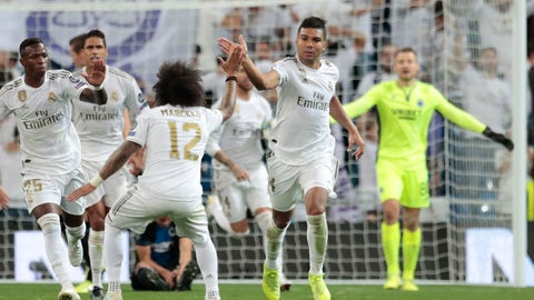 <p>               Real Madrid's Casemiro, right, celebrates his goal against Brugge during the Champions League group A soccer match between Real Madrid and Club Brugge, at the Santiago Bernabeu stadium in Madrid, Tuesday, Oct. 1, 2019. (AP Photo/Bernat Armangue)             </p>