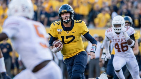 <p>               West Virginia quarterback Austin Kendall (12) runs the ball during the second half of an NCAA college football game against Texas, Saturday, Oct. 5, 2019, in Morgantown, W.Va. (AP Photo/Raymond Thompson)             </p>