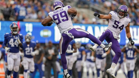 <p>               Minnesota Vikings middle linebacker Eric Kendricks (54) and defensive end Danielle Hunter (99) celebrate after a defensive play against the New York Giants during the third quarter of an NFL football game, Sunday, Oct. 6, 2019, in East Rutherford, N.J. (AP Photo/Adam Hunger)             </p>