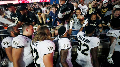 <p>               Wake Forest players celebrate with fans after defeating Boston College during an NCAA college football game in Boston, Saturday, Sept. 28, 2019. (AP Photo/Michael Dwyer)             </p>
