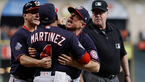 <p>               Washington Nationals manager Dave Martinez has to be restrained after being ejected for arguing an interference call during the seventh inning of Game 6 of the baseball World Series against the Houston Astros Tuesday, Oct. 29, 2019, in Houston. (AP Photo/Matt Slocum)             </p>