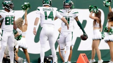 <p>               New York Jets quarterback Sam Darnold (14) celebrates a touchdown with Robby Anderson (11) during the first half of an NFL football game against the Dallas Cowboys, Sunday, Oct. 13, 2019, in East Rutherford, N.J. (AP Photo/Adam Hunger)             </p>