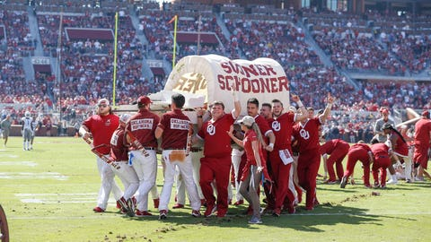 <p>               The Oklahoma Sooner Schooner is carried off the field after it tipped over during a celebratory run following a Sooner touchdown during the first half of an NCAA college football game against West Virginia in Norman, Okla., Saturday, Oct. 19, 2019. (AP Photo/Alonzo Adams)             </p>