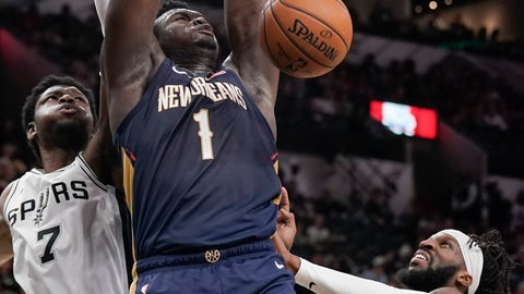 <p>               New Orleans Pelicans' Zion Williamson (1) dunks as he is defended by San Antonio Spurs' Chimezie Metu (7) and DeMarre Carroll during the first half of an NBA preseason basketball game, Sunday, Oct. 13, 2019, in San Antonio. (AP Photo/Darren Abate)             </p>