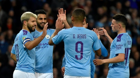 <p>               Manchester City's Sergio Aguero, left, celebrates with teammates after scoring his side's third goal during the English League Cup soccer match between Manchester City and Southampton at Etihad stadium in Manchester, England, Tuesday, Oct. 29, 2019. (AP Photo/Rui Vieira)             </p>