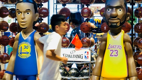 <p>               A man walks past statues of NBA players Stephen Curry of the Golden State Warriors, left, and Lebron James of the Los Angeles Lakers holding Chinese flags in the entrance of an NBA merchandise store in Beijing, Tuesday, Oct. 8, 2019. Chinese state broadcaster CCTV announced Tuesday it will no longer air two NBA preseason games set to be played in the country. (AP Photo/Mark Schiefelbein)             </p>