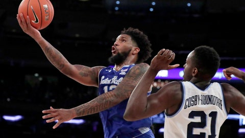 <p>               FILE- In this March 16, 2019, file photo, Seton Hall guard Myles Powell, left, goes up for a shot against Villanova forward Dhamir Cosby-Roundtree during the second half of an NCAA college basketball game in the championship of the Big East Conference tournament in New York. With preseason All America Myles Powell and three other starters back, it's no surprise Seton Hall is No. 12.(AP Photo/Julio Cortez, File)             </p>