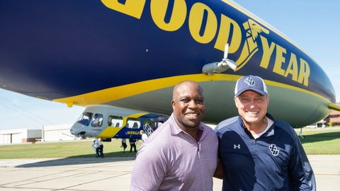 <p>               FILE - In this Friday, Sept. 27, 2019, file photo, College Football Hall of Fame inductee London Fletcher, left, and his high school and college coach Mike Moran pose following their surprise reunion and ride on the Goodyear Blimp in Cleveland. It's been an emotional whirlwind lately for Fletcher, who was enshrined last week in the Washington Redskins' Ring of Honor. He'll soon become a member of the College Football Hall of Fame — inducted along with Goodyear's iconic blimp, the first non-player or coach elected. (AP Photo/Phil Long, File)             </p>