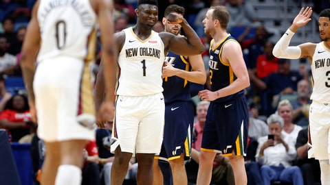 <p>               New Orleans Pelicans forward Zion Williamson (1) reacts after scoring a basket against the Utah Jazz during the second half of a preseason NBA basketball game in New Orleans, Friday, Oct. 11, 2019. The Pelicans won 128-127. (AP Photo/Tyler Kaufman)             </p>