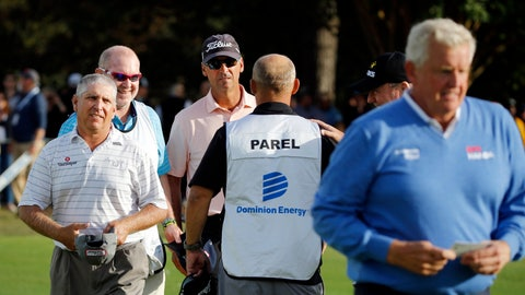 <p>               Co-leaders Scott Parel, left, and Tommy Toles, wearing cap, walk off the final hole at 12 under par, one stroke ahead of Colin Montgomerie, right, after the second round of the Dominion Energy Charity Classic golf tournament in Richmond, Va., Saturday, Oct. 19, 2019. Montgomerie missed a tying birdie attempt after engaging noisy fans in the stands. (Joe Mahoney/Richmond Times-Dispatch via AP)             </p>