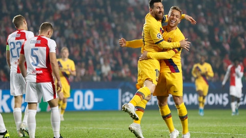 <p>               Barcelona's Lionel Messi, front left, celebrates with Barcelona's Arthur after scoring his side's opening goal during the Champions League group F soccer match between Slavia Praha and FC Barcelona at the Sinobo stadium in Prague, Czech Republic, Wednesday, Oct. 23, 2019. (AP Photo/Petr David Josek)             </p>