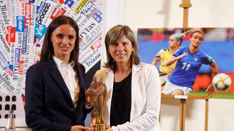 <p>               The coach of the Italian women national soccer team, Milena Bertolini, and forward Barbara Bonansea, left, pose with the Invictus sports award, at the Foreign Press Association in Rome, Monday, Oct. 21, 2019. The Italy women's team was awarded Monday with the Foreign Press Association's Invictus sports award for raising the profile of the women's game by reaching the World Cup quarterfinals. (AP Photo/Andrew Medichini)             </p>