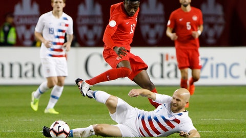 <p>               U.S. midfielder Michael Bradley (4) tackles Canada midfielder Alphonso Davies (12) during the first half of a CONCACAF Nations League soccer match Tuesday, Oct. 15, 2019, in Toronto. (Cole Burston/The Canadian Press via AP)             </p>