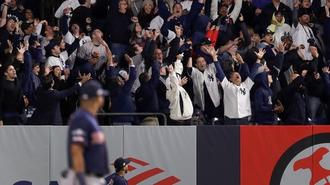 <p>               Baseball fans react after a solo home run by New York Yankees' Brett Gardner against the Minnesota Twins during the sixth inning of Game 1 of an American League Division Series baseball game, Friday, Oct. 4, 2019, in New York. (AP Photo/Frank Franklin II)             </p>