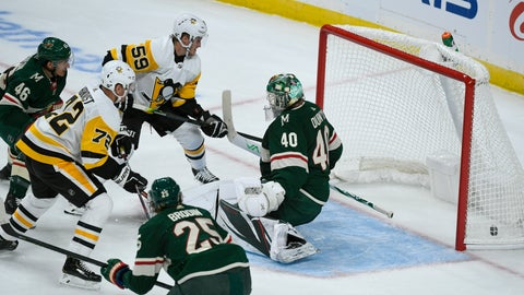<p>               Pittsburgh Penguins winger Patric Hornqvist, left, shoots the puck past Minnesota Wild goalie Devan Dubnyk (40) to score as Penguins winger Jake Guentzel (59), Wild defenseman Jared Spurgeon (46)and Wild defenseman Jonas Brodin (25) watch during the first period of an NHL hockey game Saturday, Oct. 12, 2019, in St. Paul, Minn. (AP Photo/Craig Lassig)             </p>