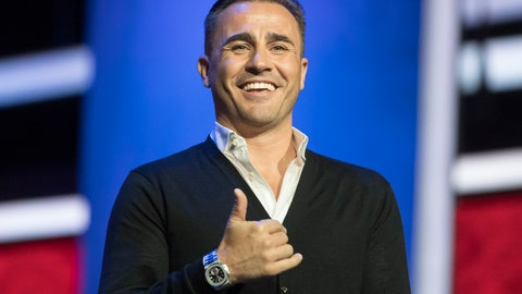 "<p>               FILE - In this Nov. 30, 2017, file photo, draw assistant and former Italian soccer player Fabio Cannavaro smiles during a photocall in the State Kremlin Palace in Moscow, Russia. Cannavaro's future as head coach of the Chinese Super League's Guangzhou Evergrande has been called into question after the team issued a notice saying he'd been ordered to corporate headquarters to attend an ""enterprise culture studies class."" (AP Photo/Pavel Golovkin, File)             </p>"