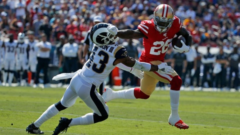 <p>               San Francisco 49ers running back Tevin Coleman (26) runs around Los Angeles Rams strong safety John Johnson (43) to score a touchdown during the first half of an NFL football game Sunday, Oct. 13, 2019, in Los Angeles. (AP Photo/John Locher )             </p>
