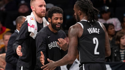 <p>               Brooklyn Nets guard Dzanan Musa, left, and /guard Kyrie Irving, center, greet forward Taurean Prince (2) as he comes into the bench during a timeout in the first half of an exhibition NBA basketball game against the Sesi/Franca Basketball Club, Friday, Oct. 4, 2019, in New York. (AP Photo/Mary Altaffer)             </p>