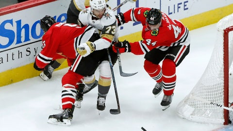 <p>               Chicago Blackhawks defenseman Connor Murphy (5) and teammate Calvin de Haan (44) check Vegas Golden Knights center Brandon Pirri behind the net during the second period of an NHL hockey game Tuesday, Oct. 22, 2019, in Chicago. (AP Photo/Charles Rex Arbogast)             </p>