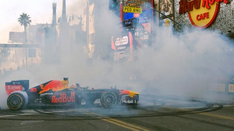 <p>               Red Bull Racing driver Max Verstappen does doughnuts along Hollywood Boulevard in front of the Hard Rock Cafe in the Hollywood section of Los Angeles on Wednesday, Oct. 30, 2019. The street was thronged with thousands of fans craning for a glimpse of the drivers whose sport has worldwide popularity, but makes a relatively small imprint on the lucrative U.S. market. With the United States Grand Prix in Texas this weekend, the drivers were eager to raise F1's profile on the West Coast. (AP Photo/Richard Vogel)             </p>
