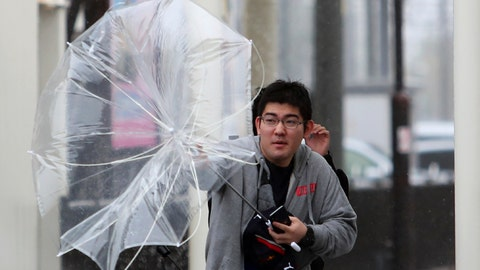 <p>               A man struggles with his umbrella against strong wind as Typhoon Hagibis approaches Suzuka, central Japan, Saturday, Oct. 12, 2019. Tokyo and surrounding areas braced for a powerful typhoon forecast as the worst in six decades, with streets and trains stations unusually quiet Saturday as rain poured over the city. (AP Photo/Toru Takahashi)             </p>