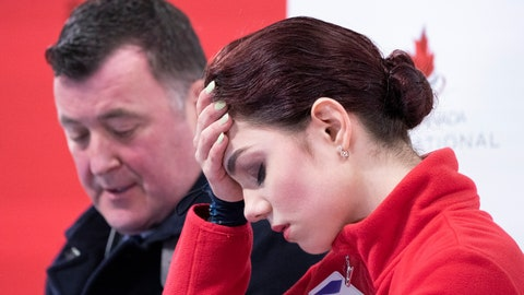 <p>               Evgenia Medvedeva, right, of Russia reacts following her short program nest to her coach Brain Orser at the Skate Canada International figure skating event in Kelowna, British Columbia, Friday, Oct. 25, 2019. (Paul Chiasson/The Canadian Press via AP)             </p>
