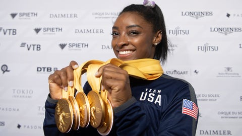 <p>               Simone Biles of the United States shows her five gold medals she won at the Gymnastics World Championships in Stuttgart, Germany, Sunday, Oct. 13, 2019. (Marijan Murat/dpa via AP)             </p>