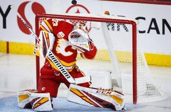 Rittich earns a shutout, Flames blank Canucks 3-0
