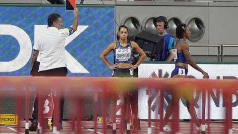 <p>               Brianna Mcneal, of the United States, right, walks away after being disqualified for a false start in a the women's 100 meter hurdles heat at the World Athletics Championships in Doha, Qatar, Saturday, Oct. 5, 2019. (AP Photo/Petr David Josek)             </p>