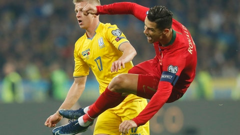 <p>               Portugal's Cristiano Ronaldo, right, fights for the ball with Ukraine's Oleksandr Zinchenko during the Euro 2020 group B qualifying soccer match between Ukraine and Portugal at the Olympiyskiy stadium in Kyiv, Ukraine, Monday, Oct. 14, 2019. (AP Photo/Efrem Lukatsky)             </p>