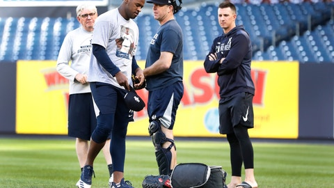 <p>               New York Yankees pitching coach Larry Rothschild, back left, watches as starting pitcher Luis Severino, second from left, gathers his belongings after a brief workout, Monday, Oct. 14, 2019, at Yankee Stadium in New York on an off day during the American League Championship Series against the Houston Astros. (AP Photo/Kathy Willens)             </p>