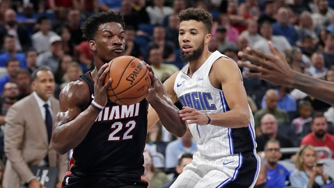 <p>               Miami Heat forward Jimmy Butler (22) passes the ball in front of Orlando Magic guard Michael Carter-Williams, right, during the first half of an NBA preseason basketball game, Thursday, Oct. 17, 2019, in Orlando, Fla. (AP Photo/John Raoux)             </p>