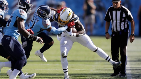 <p>               Los Angeles Chargers running back Melvin Gordon, center, is pushed out of bounds by Tennessee Titans cornerback Malcolm Butler (21) in the first half of an NFL football game Sunday, Oct. 20, 2019, in Nashville, Tenn. (AP Photo/James Kenney)             </p>