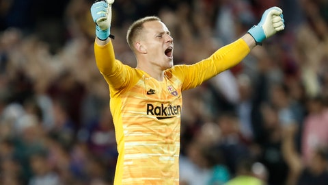<p>               FILE - In this file photo dated Wednesday, Oct. 2, 2019, Barcelona's goalkeeper Marc-Andre ter Stegen celebrates during a group F Champions League soccer match against Inter Milan at the Camp Nou stadium in Barcelona, Spain.  Ter Stegen has been critical of his team's performance Wednesday Oct. 23, 2019, in the Czech capital after he had to come to his team's rescue in a 2-1 win over European minnow Slavia Prague.  (AP Photo/Joan Monfort, FILE)             </p>