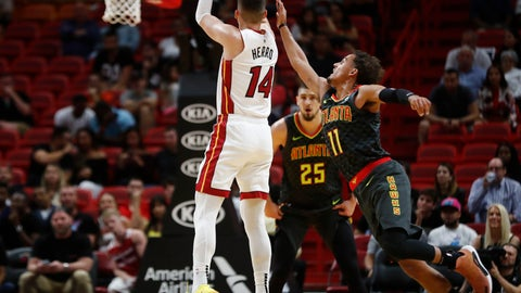 <p>               Miami Heat guard Tyler Herro (14) shoots and scores against Atlanta Hawks guard Trae Young (11) during the first half of an NBA preseason basketball game Monday, Oct. 14, 2019, in Miami. (AP Photo/Brynn Anderson)             </p>
