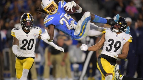 <p>               Los Angeles Chargers defensive back Rayshawn Jenkins, center, trips as he runs the ball past Pittsburgh Steelers cornerback Cameron Sutton, left, and lfree safety Minkah Fitzpatrick during the first half of an NFL football game, Sunday, Oct. 13, 2019, in Carson, Calif. (AP Photo/Kyusung Gong)             </p>