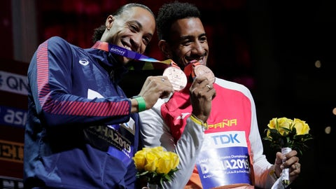 <p>               Joint bronze medalists Orlando Ortega, of Spain, right, and Pascal Martinot-Lagarde, of France, smile during the award ceremony for the men's 110 meter hurdles at the World Athletics Championships in Doha, Qatar, Thursday, Oct. 3, 2019. (AP Photo/Nariman El-Mofty)             </p>